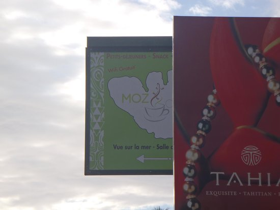 Moz Cafe: Look for the green sign. It's near Moorea Pearl Resort and all stores.