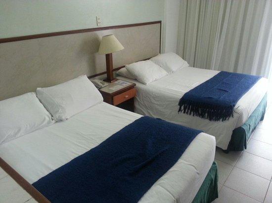 Margarita Dynasty Hotel & Suites: Camas...