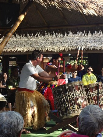Polynesian Cultural Center: My husband was called up to try his hand at drumming