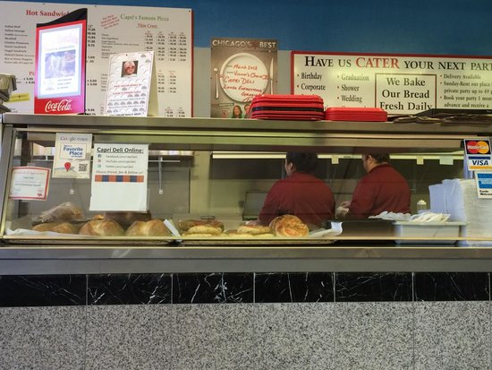 Capri Deli and Pizza: Fresh breads on display while my sandwich is being constructed.