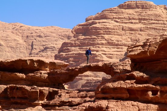 Wadi Rum: My guide took this amazing shot while I was crossing a natural stone bridge.