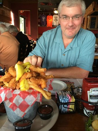 The Original Crabcake Factory: My husband with the shrimp basket appetizer