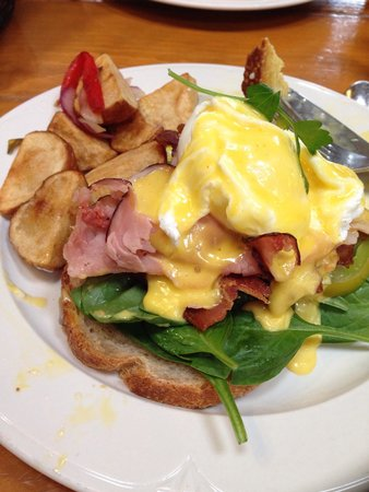 Costeaux French Bakery: Eggs Benedict with heirloom tomatoes, spinach, applewood bacon, ham, on sourdough bread.