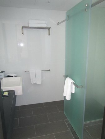 Four Points by Sheraton Brisbane: View into the bathroom showing the sliding door that covers the commode or the shower