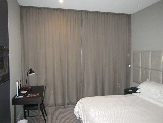 Four Points by Sheraton Brisbane: View of the window wall with the curtains drawn, if you lower the electric cover it does get dar