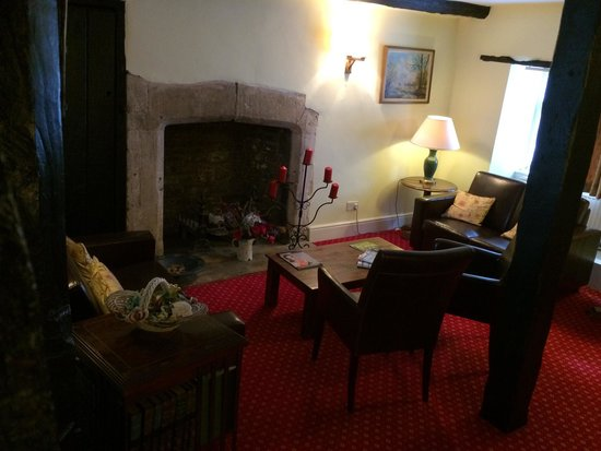 The Bull at Burford: The lounge & fireplace
