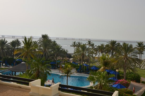 JA Jebel Ali Beach Hotel : One of the pools and the beach from the room