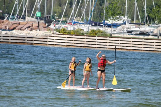 Door County Adventure Center - Day Tours: girls paddleboarding