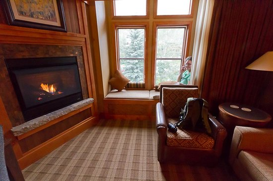 Wyoming Inn of Jackson Hole : Nice fireplace.  Teenagers find the window seat a good place to call friends