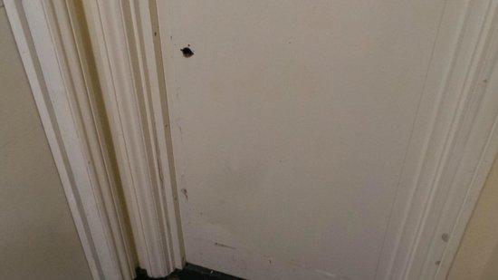 The Osborne Hotel: Typical internal door - marked, dirty, and with holes