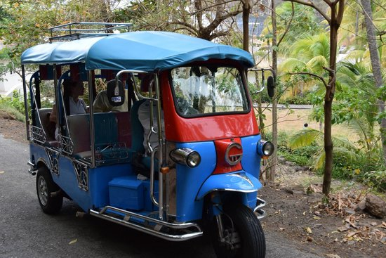 Sugar Beach, A Viceroy Resort: One of Sugar Beach's Tuk Tuk's - fun little cars for transporting guests around the property