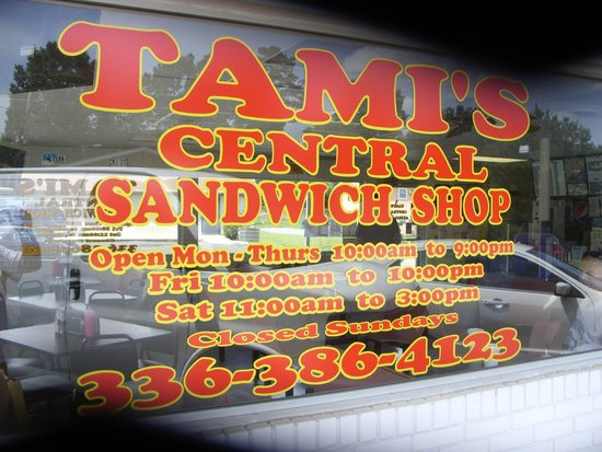 Tami's Central Sandwich shop : Window sign with open / close hours