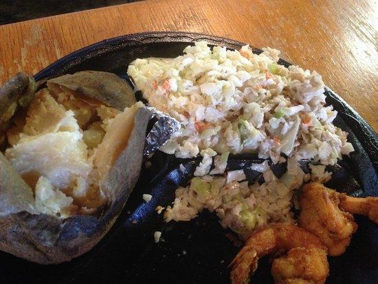 Singleton's Seafood Shack: Old dry baked potato.  Old slaw on right, fresher slaw on left.