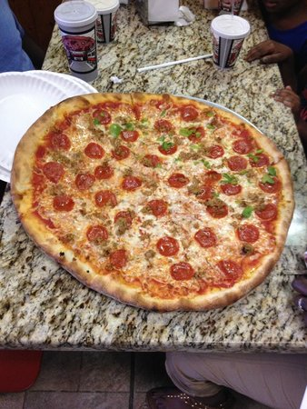 "Luigi's Pizza: ""Medium"" pizza  18 inches across.  Pepperoni, sausage and half green peppers"