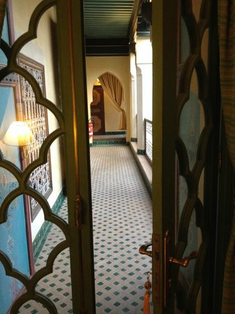 Riyad Al Moussika: Glass doors to single room and outer wooden doors