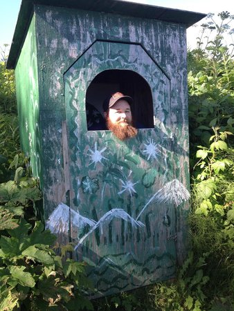 Seaside Farm: joking around at our outhouse (no, he isn't really using it here!)