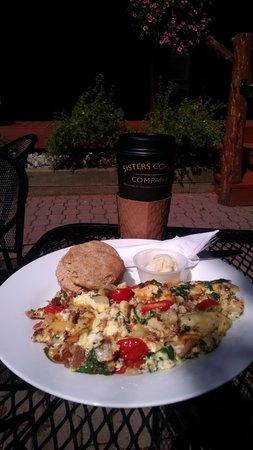 Sisters Coffee Company: Blackboard Special & Latte in the Outside Seating
