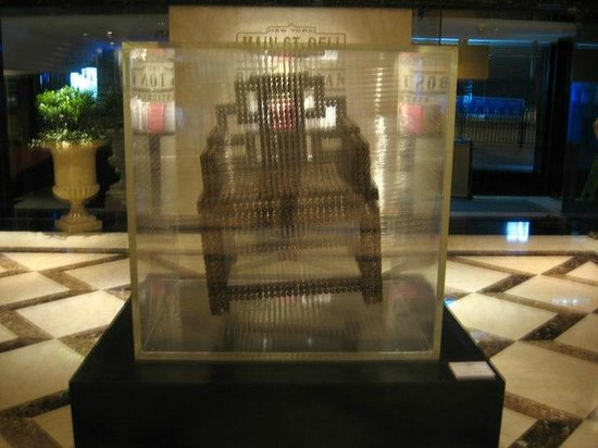 The Langham, Hong Kong: Chair was made from coins in the Langham hotel