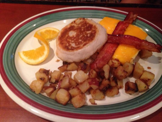 Clear Sky Cafe: Bacon, egg, cheese sandwich in English muffin, with home fries.
