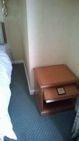 Merdeka Palace Hotel & Suites: Bed side table, get up to use.