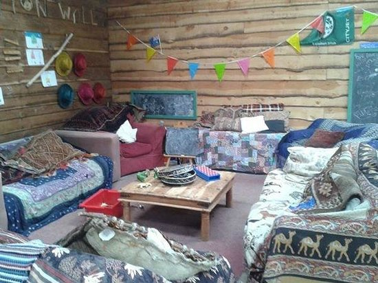 Blackdown Yurts - Yurt Holidays in Devon: The Field Kitchen in the barn and sitting area