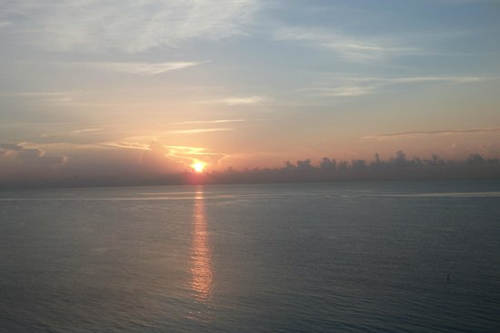Pelican Grand Beach Resort, A Noble House Resort : Sunrise from the balcony