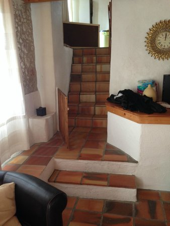 Manoir de Longeveau : stairs from living area to kitchen