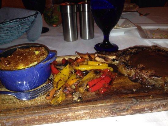 Ario Restaurant: Bone in ribeye , roasted veggies, and oven bake potatoes.