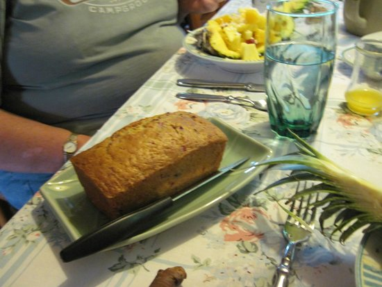 Maple House Bed & Breakfast: Cranberry orange bread, pineapple boat in the background.