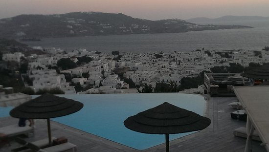 Vencia Hotel : The pool at dusk, seen from the restaurant terrace