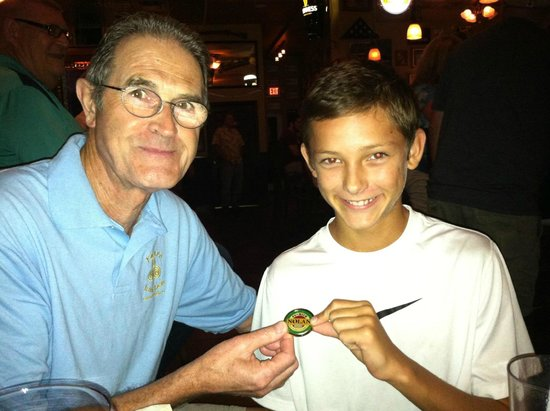 Nolan's Irish Pub: Owner John visits with a young customer