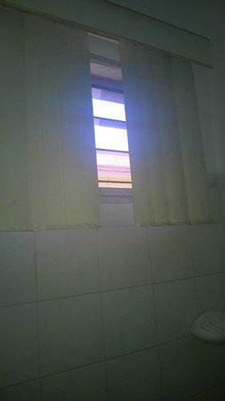 Apart Hotel Villa Nuria: pared del baño