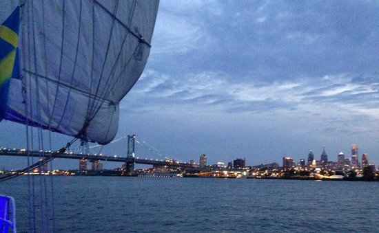 American Sailing Tours: The sail looming over the Philadelphia skyline at dusk.