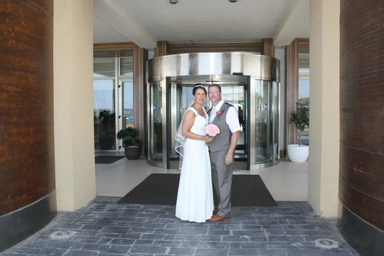 db Seabank Resort + Spa: My wife and I stood in the entrance to the hotel after our wedding.