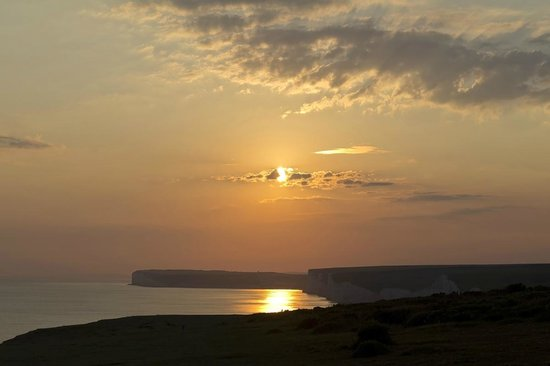 Belle Tout Lighthouse: View of coastline near Belle Tout at sunset.