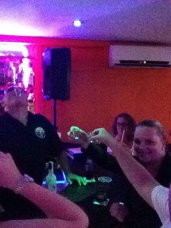 Juke Box Bar: Domingo and Monica doing shots with us