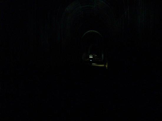 Hiawatha Mountain Bike Trail: bicyclist with head lamp way ahead inside the first tunnel