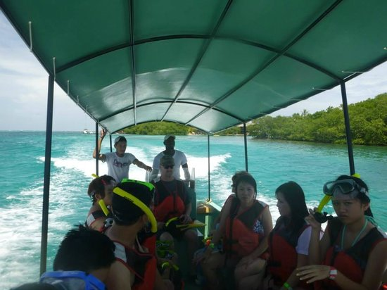 Little French Key: Boat that takes people to snorkeling site and our guides in back. (Hard working guys)