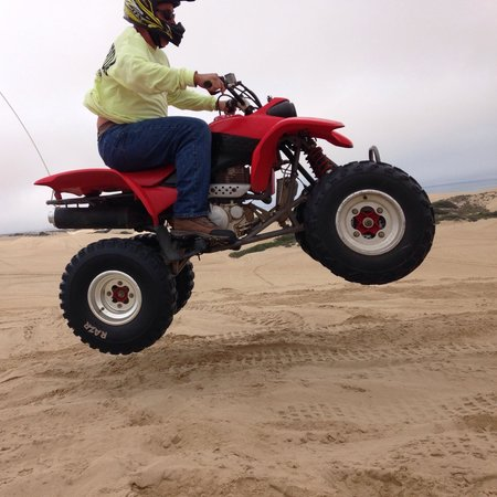 Arnie's ATV Rentals: Getting a wee-bit of air on the 400 Quad