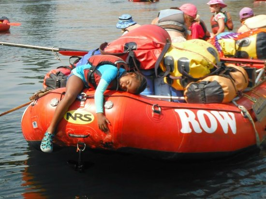 ROW Adventures - Salmon River Canyons: happily pooped kid, resting in the calm water