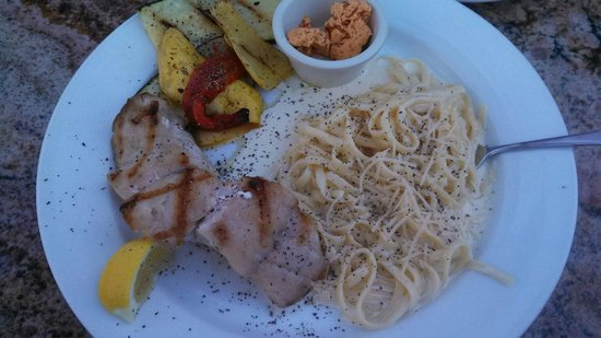 Grilled sea bass with chipotle butter and pasta alfredo
