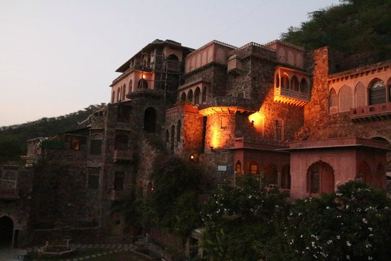 Neemrana Fort-Palace: The Rath Mahal suite's balconies are the two lit up by lights.  Almost the highest level of the