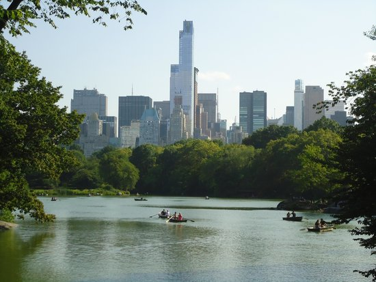Central Park: The lake with sky scrappers as a beautiful background.