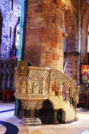 St Giles' Cathedral: St Giles' well decorated and intricately carved main pulpit attached to a main column of the chu
