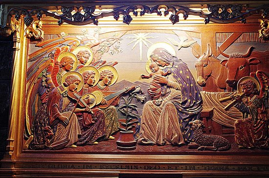 St Giles' Cathedral: Mother Mary presenting baby Jesus to wise men from the East the little Angel trumpeting behind