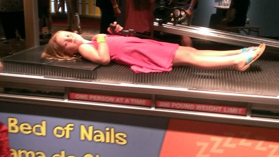 Arizona Science Center: sleeping on a bed of nails