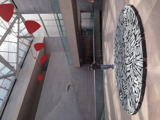 National Gallery of Art: Huge triangular patio  with a Calder  mobile