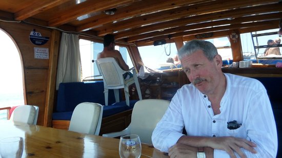 Yildiz - Day Trips : Just love the way Adem sits in the chair steering the boat