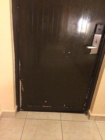 The Fajardo Inn: room 312: main door (begging for some paint!)