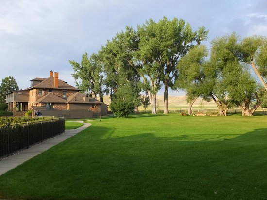 Ranch at Ucross: Manicured lawns; the main house where meals and drinks are served.